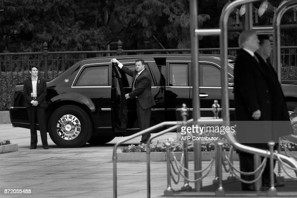 US Secret Service stand next to the presidential limo nicknamed The Beast with the doors open in case of quick escape as US President Donald Trump...