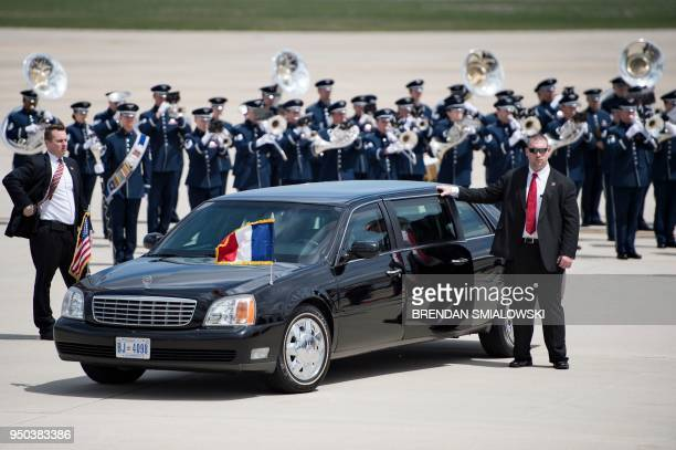 US Secret Service stand with an armored limo as French President Emmanuel Macron arrives at Joint Base Andrews in Maryland on April 23 2018 President...