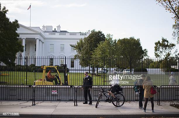 US Secret Service Uniformed Division officers stand watch near the fence line of the White House in Washington DC October 23 as construction...