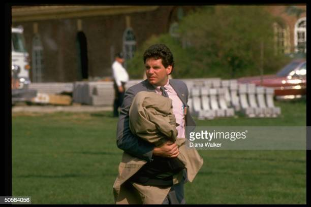 Secret serviceman carrying Pres Reagan's bulletproof raincoat during Pres's visit to Baltimore MD