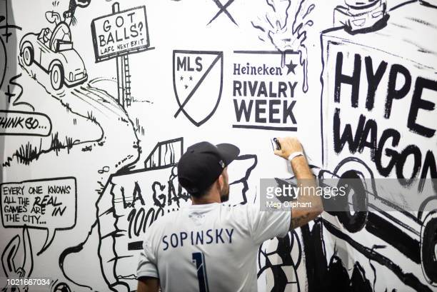 Secret Walls artists paint for their allotted 90 minutes at the MLS Heineken Rivalry Week Secret Walls event held at START Los Angeles on August 22...