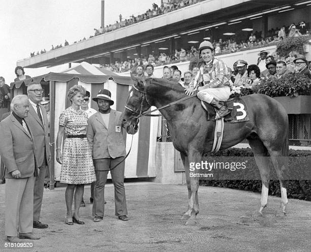 Secretariat basks in the winner's circle at Belmont Park following the 1972 Futurity surrounded by trainer Lucien Laurin Mr and Mrs John B Tweedy and...