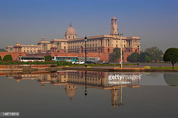 Secretariat building reflected in ornamental pool at Rajpath.