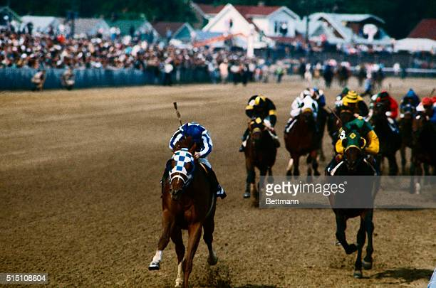 Secretariat here is ridden by Ron Turcotte as he wins the Kentucky Derby. Sham, #5 is riden by Liffit Pincay, and came in second.