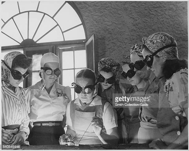 Secretaries housewives waitresses and other women from central Florida in vocational schools to learn war work during World War 2 1942 Image courtesy...