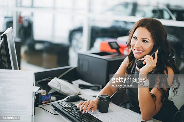 secretary at car dealership - secretary stock photos and pictures