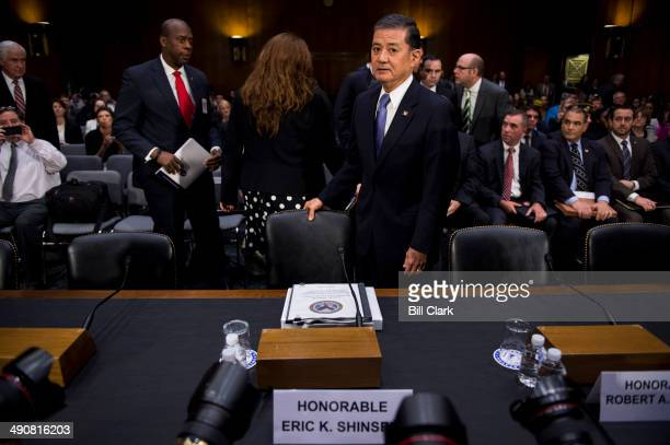 Secretary Eric Shinseki takes his seat to testify for the Senate Veterans' Affairs Committee hearing on 'The State of VA Health Care' on Thursday May...