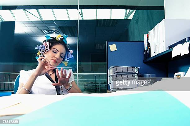 Secretary Filing Nails at Desk