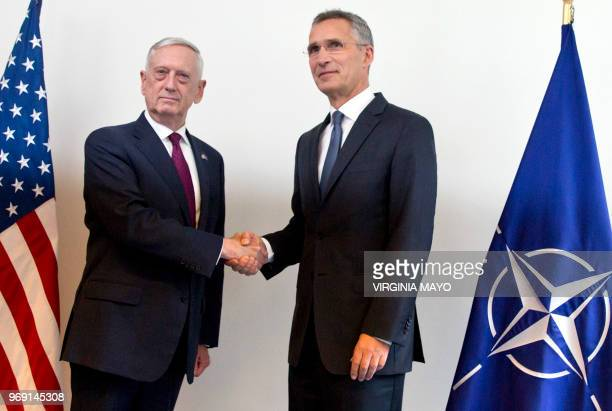 Secretary for Defense Jim Mattis shakes hands with NATO Secretary General Jens Stoltenberg during a meeting at NATO headquarters in Brussels, on June...