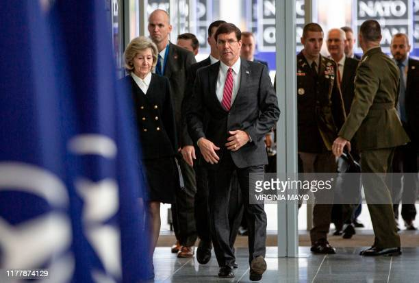 Secretary for Defense Mark Esper and US Ambassador to NATO Kay Bailey Hutchison arrive for a meeting of NATO defense ministers at NATO headquarters...