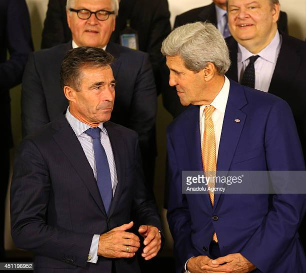 Secretary General Anders Fogh Rasmussen and US Secretary of State John Kerry seen as the logo of the Wales Summit of NATO to be held on 45 September...