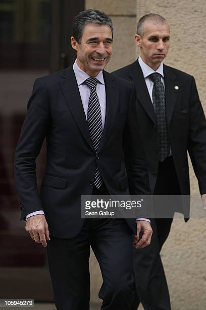 Secretary General Anders Fogh Rasmussen departs after meeting with German Foreign Minister Guido Westerwelle at the Federal Foreign Office on October...