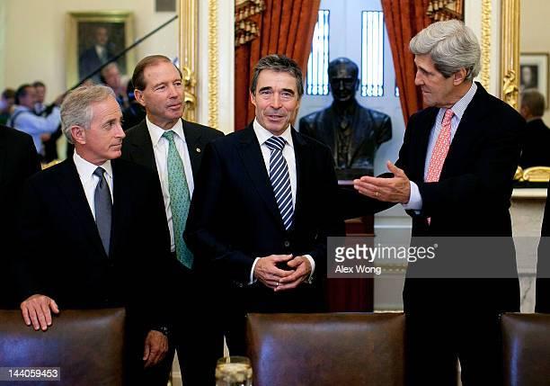 Secretary General Anders Fogh Rasmussen speaks to the media as US Sen John Kerry Sen Bob Corker and Sen Tom Udall look on prior to a meeting May 9...