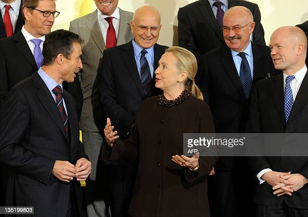Secretary General Anders Fogh Rasmussen speaks with US Secretary of State Hillary Clinton while Britain's Foreign Affairs Minister William Hague...