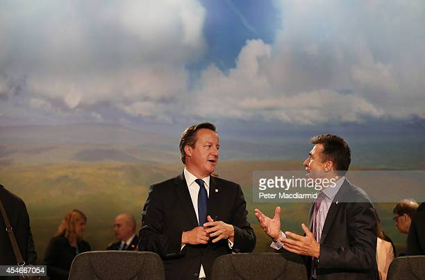 Secretary General Anders Fogh Rasmussen talks with British Prime Minister David Cameron at the NATO Summit on September 5 2014 in Newport Wales...