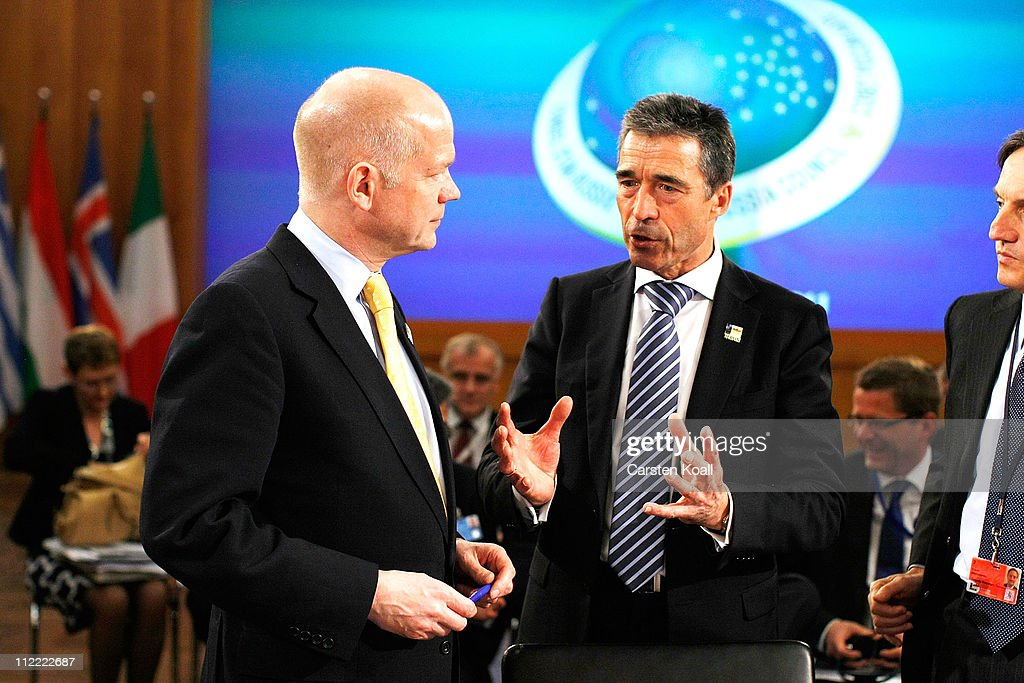 Secretary General Anders Fogh Rasmussen (R) talks with U.K. Foreign Secretary William Hague (L) at an informal meeting of NATO member foreign ministers on April 15, 2011 in Berlin, Germany. The principal focus of the two-day meeting is the alliance's military involvement in the war in Libya, though it also includes special roundtables on the alliance's relationship to Russia, Ukraine and Georgia.