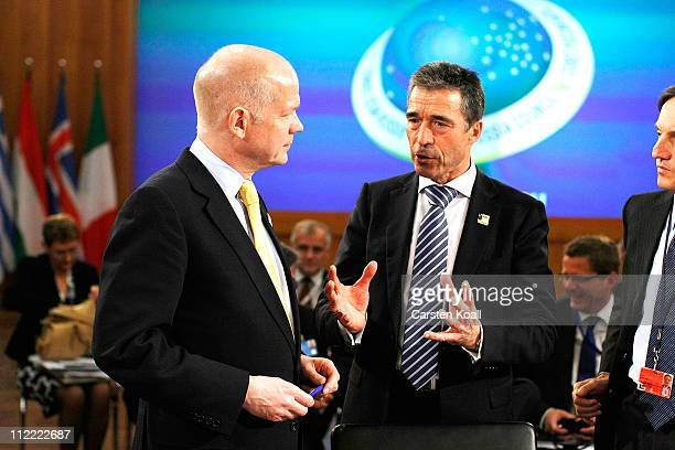 Secretary General Anders Fogh Rasmussen talks with U.K. Foreign Secretary William Hague at an informal meeting of NATO member foreign ministers on...