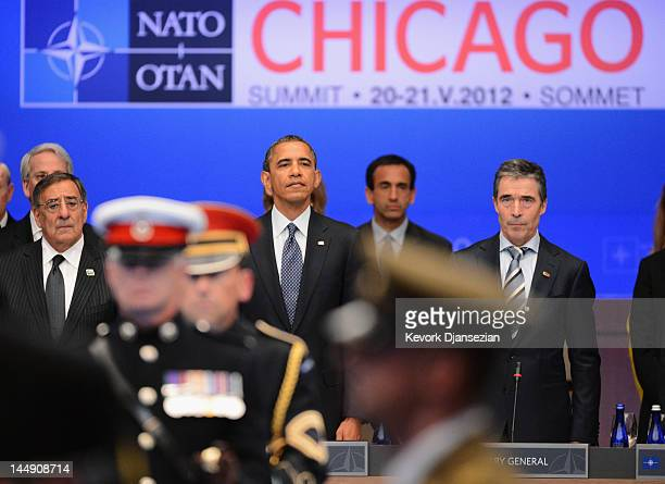 Secretary General Anders Fogh Rasmussen US President Barack Obama his Defense Secretary Leon Panetta stand for a moment of silence during the NATO...