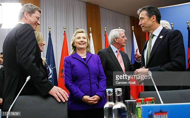 Secretary General Anders Fogh Rasmussen US Secretary of State Hillary Clinton and German Foreign Minister Guido Westerwelle arrive at an informal...