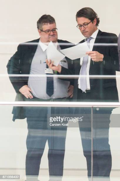 CSU secretary general Andreas Scheuer shows papers to Elmar Brok from the CDU during the second phase of coalition negotiations at the Reichstag on...