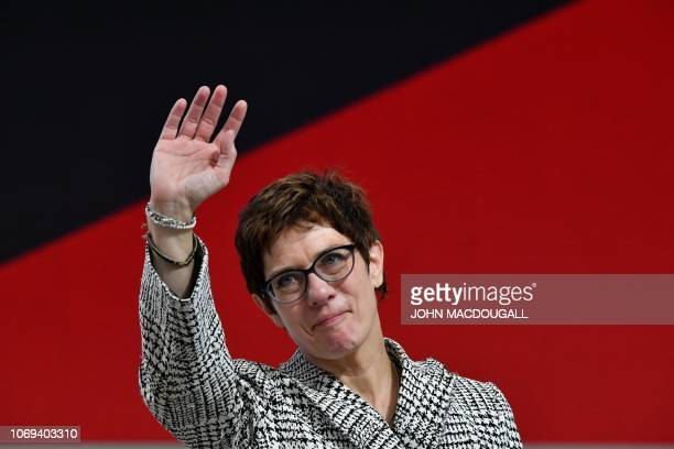 Secretary General Annegret KrampKarrenbauer waves after she was elected as leader of the centreright CDU during the party congress of Germany's...