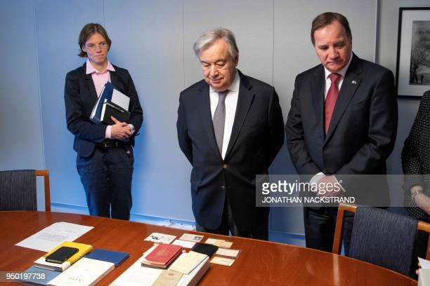 UN Secretary General António Guterres and Swedish Prime Minister Stefan Lofven look at the Dag Hammarskjold Collection ahead of deliberations at the...
