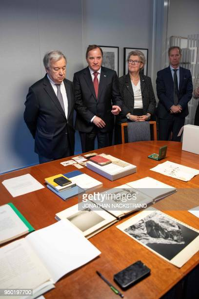 UN Secretary General António Guterres Swedish Prime Minister Stefan Lofven and Sweden's ambassador to UN Olof Skoog look at the Dag Hammarskjold...
