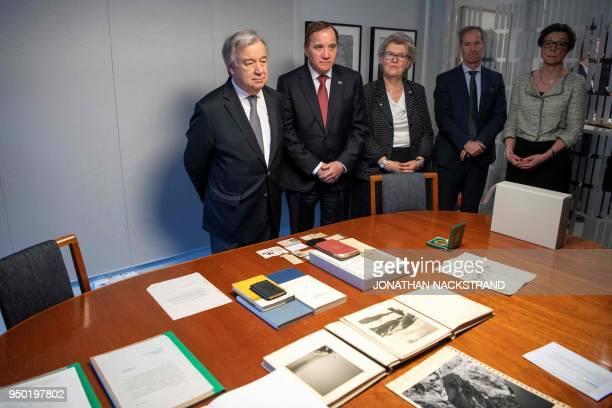 UN Secretary General António Guterres Swedish Prime Minister Stefan Lofven Sweden's ambassador to UN Olof Skoog look at the Dag Hammarskjold...