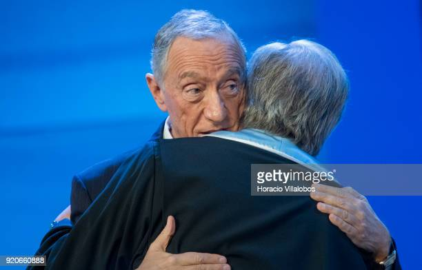 Secretary General Antonio Guterres is being embraced by Portuguese President Marcelo Rebelo de Sousa after receiving the honorary doctorate degree at...