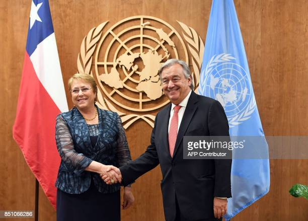 UN Secretary General Antonio Guterres meets with Chile's President Michelle Bachelet Jeria on September 21 2017 at the United Nations in New York /...