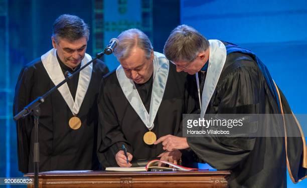 Secretary General Antonio Guterres signs the protocol after receiving from the Dean of Lisbon University Antonio da Cruz Serra the honorary doctorate...