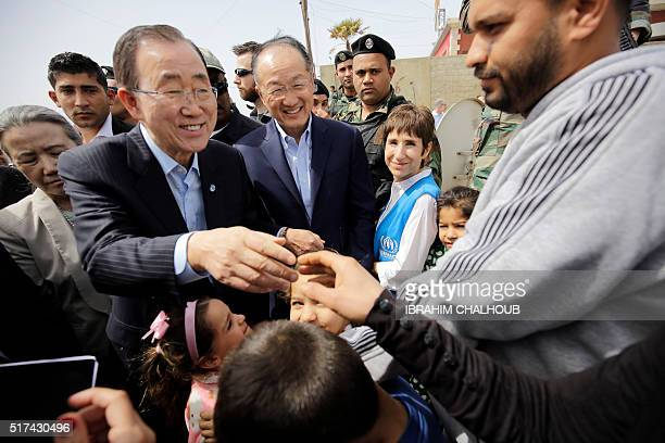 UN Secretary General Ban Kimoon and World Bank President Jim Yong Kim meet Syrian refugees during his visit in Hay alTanak an impoverished district...