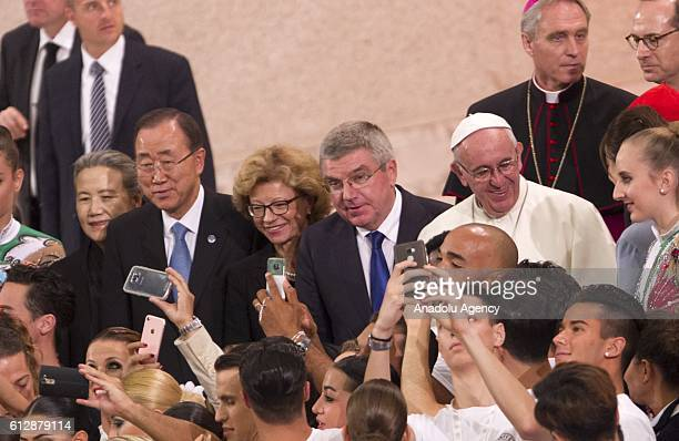 Secretary General Ban Kimoon President of International Olympic Committee Thomas Bach and Pope Francis pose with partecipants of the opening ceremony...
