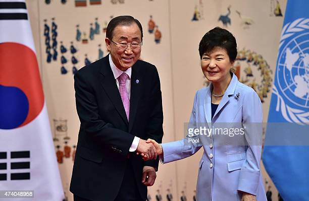 Secretary General Ban Ki-moon shakes hands with South Korean President Park Geun-Hye during their meeting at the presidential Blue House on May 20,...