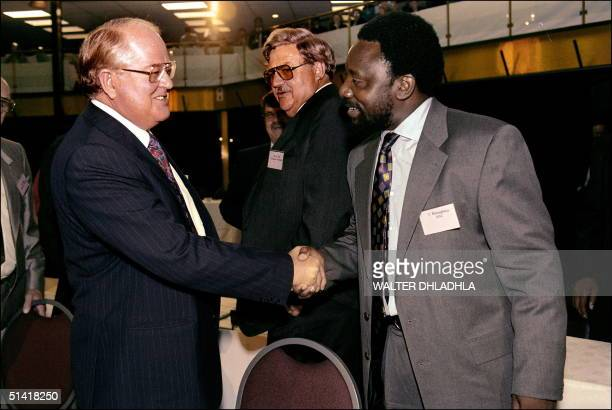 Secretary General Cyril Ramaphosa greets the leader of conservative Afrikaner-Volksune Andries Beyers at a multi-party conference 05 March 1993 in...