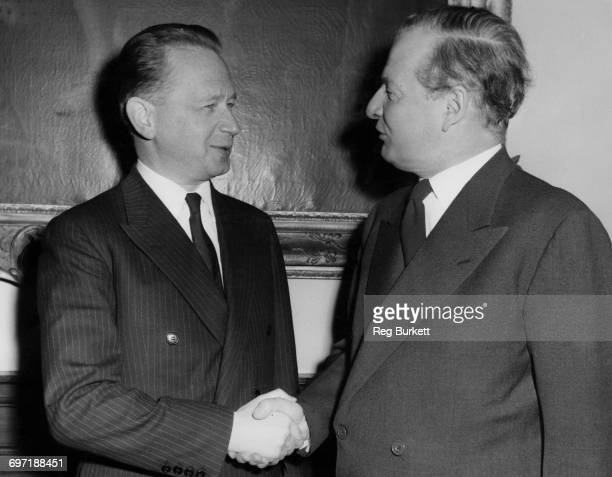 UN Secretary General Dag Hammarskjöld and British Foreign Secretary Selwyn Lloyd shaking hands prior to a meeting at the Foreign Office London 31st...