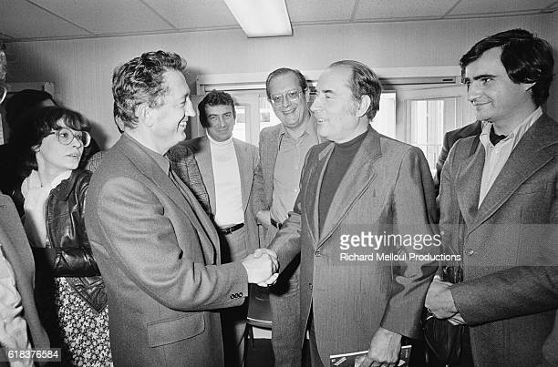 Secretary General Edmond Maire shakes hands with Socialist leader Francois Mitterrand during a meeting in Paris Maire led the CFDT from 1971 to 1988