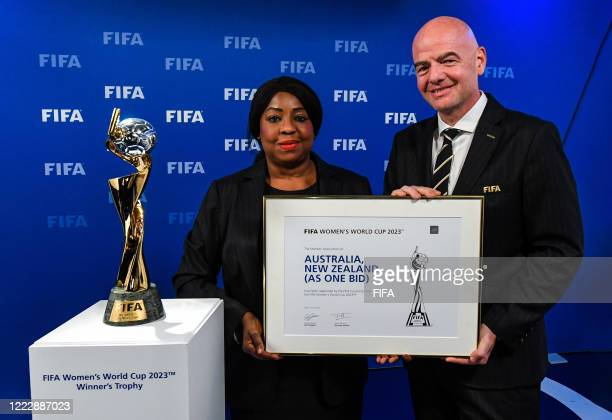 Secretary General Fatma Samoura and FIFA President Gianni Infantino pose with the Women's World Cup Trophy after the announcement that...