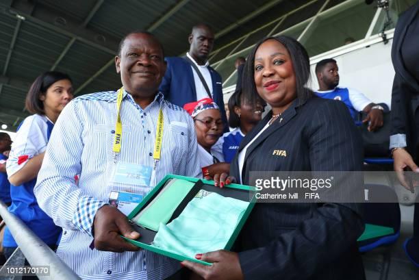 Secretary General Fatma Samoura presents a gift to Yves JeanBart president of the Haiti Football Association during the FIFA U20 Women's World Cup...