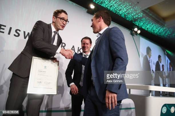 Secretary General Friedrich Curtius congratulates Hannes Wolf for being awarded 'Coach of the Year' during the Coaching Award Ceremony Closing Event...