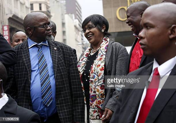 ANC Secretary General Gwede Mantashe ANC stalwart Winnie MadikizelaMandela and ANCYL President Julius Malema outside the Johannesburg High Court on...