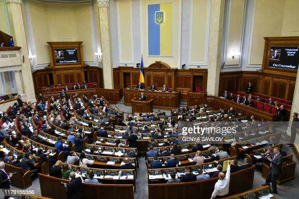 Secretary General Jens Stoltenberg addresses lawmakers during a session of the parliament in Kiev on October 31, 2019.