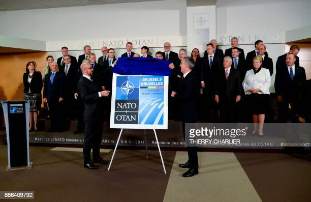 Secretary General Jens Stoltenberg and Belgian Prime Minister Charles Michel unveil the Brussels 2018 NATO Summit Logo during a NATO Foreign Affairs...