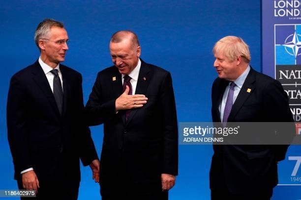Secretary General Jens Stoltenberg and Britain's Prime Minister Boris Johnson greet Turkey's President Recep Tayyip Erdogan upon arrival for the NATO...