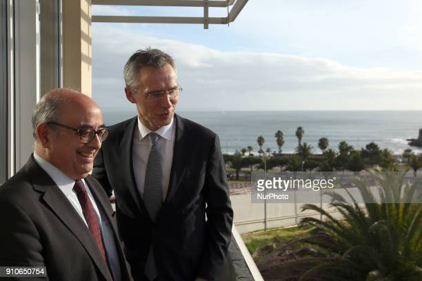 Secretary General Jens Stoltenberg and Portugal's Defence Minister Jose Alberto Azeredo Lopes laugh during a visit to the Naval Striking and Support...