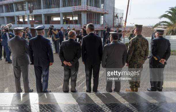 Secretary General Jens Stoltenberg and Portuguese Defense Minister Jose Azeredo Lopes pose for pictures at the end of their visit to NATO's...