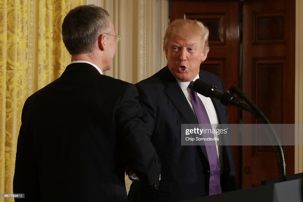 Secretary General Jens Stoltenberg (L) and U.S. President Donald Trump shake hands at the conclusion of a news conference in the East Room of the White House April 12, 2017 in Washington, DC. Trump reaffirmed the United States' commitment to the North Atlantic alliance and its 'ironclad' pledge to defend NATO allies, even though he repeatedly questioned the relevance of the military organization during the campaign.