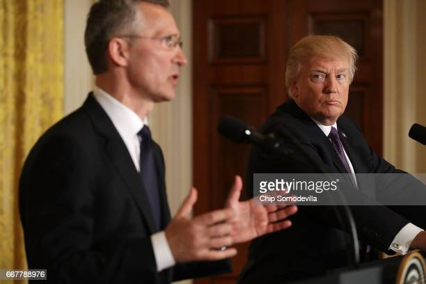 Secretary General Jens Stoltenberg and US President Donald Trump hold a news conference in the East Room of the White House April 12 2017 in...