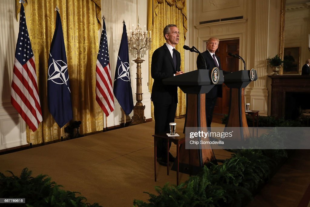 Secretary General Jens Stoltenberg (L) and U.S. President Donald Trump hold a news conference in the East Room of the White House April 12, 2017 in Washington, DC. Trump reaffirmed the United States' commitment to the North Atlantic alliance and its 'ironclad' pledge to defend NATO allies, even though he repeatedly questioned the relevance of the military organization during the campaign.