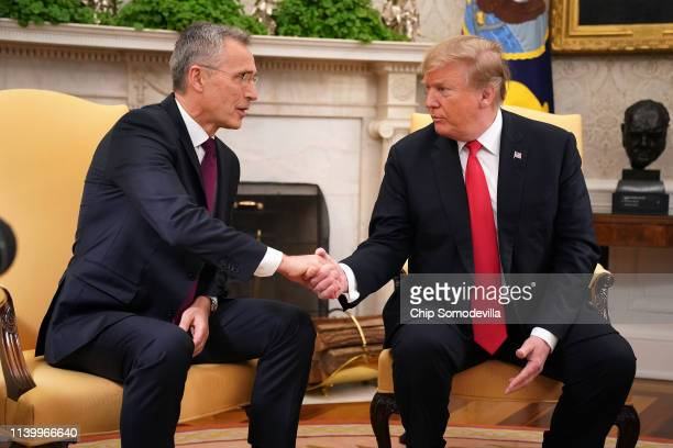 Secretary General Jens Stoltenberg and US President Donald Trump shake hands in the Oval Office at the White House April 02 2019 in Washington DC On...